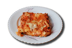 Typical italian dish - Lasagna. This is a typical Italian dish. It is composed of layers of puff pastry and tomato sauce, mozzarella, white sauce, minced meat Royalty Free Stock Photo