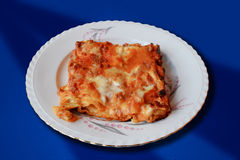 Typical italian dish - Lasagna. This is a typical Italian dish. It is composed of layers of puff pastry and tomato sauce, mozzarella, white sauce, minced meat Stock Images