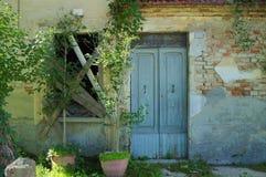 Typical Italian façade of an abandoned house. Urbino, Italy royalty free stock photo