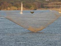 Typical italian fishing net along the river Arno in Marina di Pisa, Tuscany, Italy Stock Images