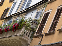 Typical Italian house balcony with flowers Royalty Free Stock Photography