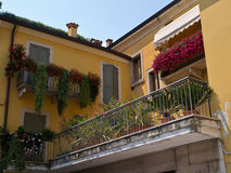 Typical Italian house balcony with flowers royalty free stock image