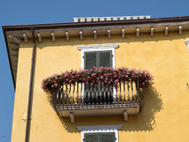 Typical Italian house balcony with flowers stock photography