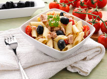 Typical italian Penne with olives and tuna Royalty Free Stock Photos