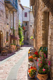 Typical Italian restaurant in the historic alley. Of Assisi, Italy Royalty Free Stock Image