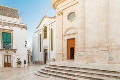 Typical Italian square in small village in Apulia. Typical Italian square with church in small village in Apulia Stock Photos