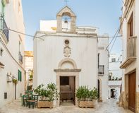 Typical Italian square in small village in Apulia. Typical Italian square with church in small village in Apulia Royalty Free Stock Photos