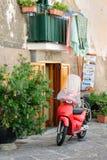 Typical Italian street scene. Evidence of a simple, quiet life. SORRENTO, ITALY - SEPTEMBER 27, 2012: Nostalgic vacation theme. Italy. Wet laundry hangs to dry Royalty Free Stock Photo