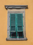 Typical Italian window with blinds half open Royalty Free Stock Image