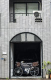 Typical Japanese garage. With car and electrical bicycle in Tokyo stock photos
