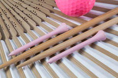 Typical Japanese hand fan, chopsticks and golf equipments Royalty Free Stock Photography