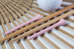 Typical Japanese hand fan, chopsticks and golf equipments Stock Photography