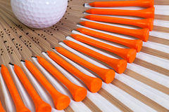 Typical Japanese hand fan and golf equipments Stock Photography