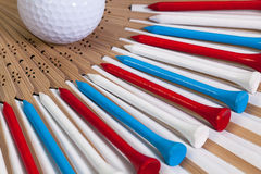 Typical Japanese hand fan and golf equipments Royalty Free Stock Photography