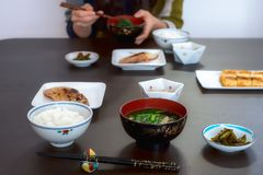 Typical Japanese lunch meal in Yamagata with fish, soup and rice. Typical Japanese lunch or breakfast set meal in Sagae at Yamagata-shi with fish, miso soup and stock images
