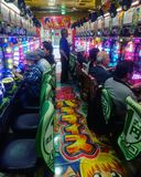 Typical Japanese Pachinko arcade with people gambling royalty free stock image