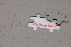 A typical jigsaw puzzle with regulation. A typical jigsaw puzzle with a gap and regulation . The last piece of jigsaw puzzle concept for solution and completion royalty free stock image