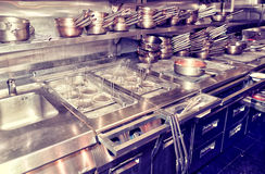 Typical kitchen of a restaurant, toned Royalty Free Stock Photography