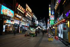 Typical korean pedestrian zone with restaurants, bars and many colorful billboard signs
