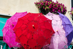 Typical lacy parasols for women on the counter street vendors of souvenirs in Venice, Italy Royalty Free Stock Photo