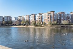 Lakeside apartment building complex with blue sky in America Stock Photo
