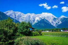 Typical landscape in the Alps with snowcapped mountain tops royalty free stock image