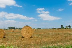 Typical landscape of the Emporda in Catalonia, Spain. Typical landscape of the Emporda in Catalonia: Round bales of straw on a stubble field in Catalonia, Spain Stock Photos