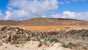 Typical landscape of Fuerteventura, Canary Islands. Scenery of the characteristic meager landscape of Fuerteventura, Canaries Royalty Free Stock Images