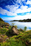 Typical landscape of norway. In the lofoten islands. A very desolate place : rocks, sea and clouds Royalty Free Stock Photography