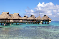 Typical landscape of tropical islands - huts, wooden houses over water Stock Images