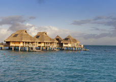 Typical landscape of tropical islands - huts, wooden houses over water Stock Photography