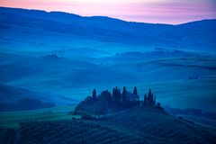 Typical landscape of Tuscany in the blue light of early morning stock photography