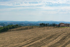 Typical landscape in Tuscany, farmhouse on the hills of Val d'Or Royalty Free Stock Image
