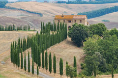 Typical landscape in Tuscany, farmhouse on the hills of Val d'Or Royalty Free Stock Photo