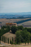 Typical landscape in Tuscany, farmhouse on the hills of Val d'Or Stock Photos