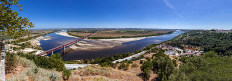 The typical Leziria alluvial plane landscape from the Ribatejo region with the Dom Luis I Bridge crossing the Tagus River Royalty Free Stock Photo