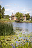 Typical lithuanian house by the lake Stock Image