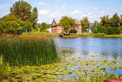 Typical lithuanian house by the lake Royalty Free Stock Photos