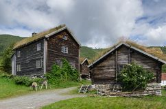 Typical log houses in the Sogn folk museum. A log farmhouse with a barn, a hut, honing wheels, pile of wood in the Norwegian open-air museum stock photos