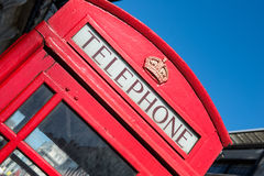 Typical London phone booth. Famous and traditional red telephone booth in one of the streets of London Stock Image