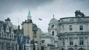 London Skyline With Flag Blowing. Typical London skyline with many old buildings stock video
