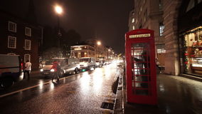 Typical London street view by night with telephone booth. LONDON, ENGLAND stock video footage