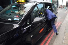 Typical London taxi on the streets of England`s capital Stock Photo