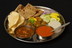 Typical Maharashtrain lunch dish with Chapati, mango juice or aamras,rice, onion and vegetable. Typical Maharashtrain lunch dish with Chapati, mango juice or royalty free stock image