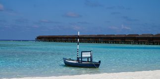 Typical Maldivian boat on the lagoon Royalty Free Stock Images