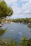 Mediterranean north coast of the island of mallorca. Typical mallorca mediterranean seaside with low luxury residentials and low vegetation over the rocks near Royalty Free Stock Photography