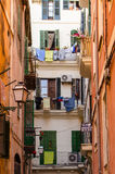 Typical Mallorcan alley street looking up. Seeing clothes drying and flowers Royalty Free Stock Image