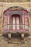 Maltese Balconey. Typical Maltese balcony in an apartment in an ancient building Royalty Free Stock Images