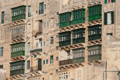 Typical Maltese covered balconies. In Valletta, Malta Stock Photos