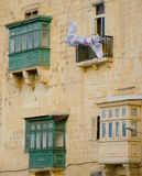 Typical Maltese covered balconies in Valletta. Old town Stock Images